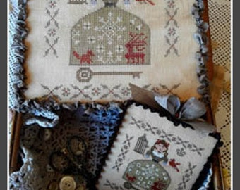 NIKYSCREATIONS Winter Girl counted cross stitch patterns at thecottageneedle.com 2018 Nashville Market
