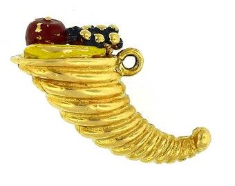 A vintage 14k yellow gold  horn or plenty charm