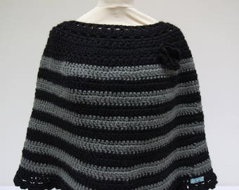 Black poncho with wide stripes and flower