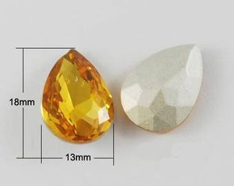 Two yellow gold faceted crystal drop cabochons 18 x 13 mm for support.