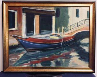 Red and Blue Boat on a Venetian Canal