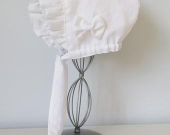 Ceremonial white linen beguin at 36 months