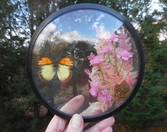 Vintage 1960s to 1970s Circular Glass With Orange and Yellow Butterfly Inside Bubble Creco Made in Taiwan Black Trim Faux Decor Flowers Pink