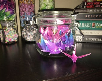 Origami cranes in glass jar with clasp