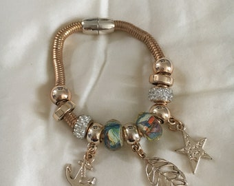 Dangling magnetic fashion braceletwith beads and trinkets