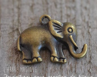 Small metal bronze Elephant charm and its 27 x 21 mm