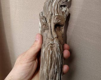 Spirit face hand carved in driftwood