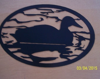 Metal Silhouette of Duck Swimming in Pond