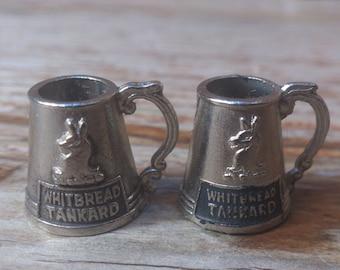 A pair of vintage Whitbread miniature tankards