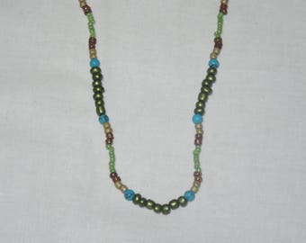 Green, brown, gold, and turquoise beaded necklace
