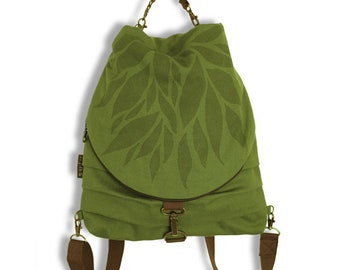 Carolin backpack and transformable fabric bag, convertible backpack in shoulder bag and handbag. Green Color, leaves.