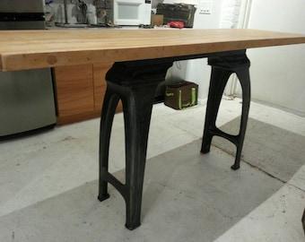 Vintage industrial cast iron lathe base with maple butcher block bar.