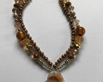 Gold and bronze beaded heart necklace