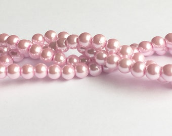 "Faux Glass Pearls, 8mm, Pink. 8mm Pink Pearls. Soft Classic pink pears. 32"" strand approximately 112 beads."