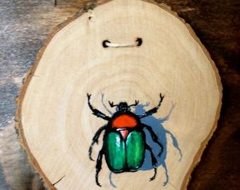 Beetle Painted on Natural Wood Slice