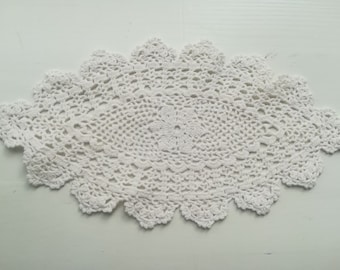 Elegant vintage handmade oval-shaped cotton doily