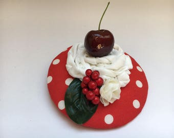 Fascination with cherry, cream and berries on red base with white Polkadots