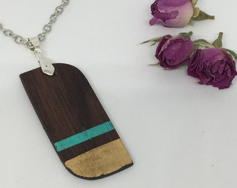 Double wood pendant, eco-walnut, gold leaf, single piece.