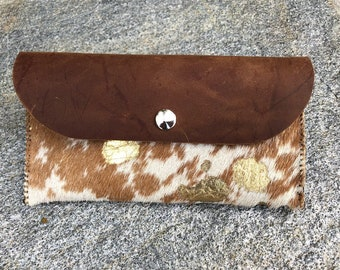 Cowhide with gold saddle cellphone pouch