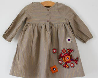 Girls upcycled khaki cotton smock dress with gold lurex stripe and Banjara embroidery detail, size 12 months
