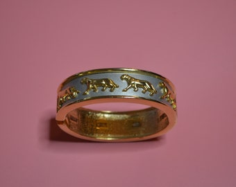 Gold and Silver Colored Bangle Bracelet with Wild Cats Around the Edge