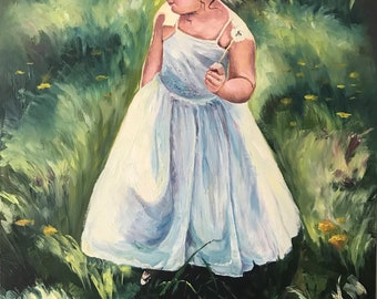 A little girl in the wild grass