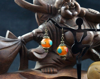 Beeswax and coral orange imitation Nepalese earrings