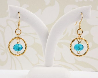 Aqua blue crystal and gold hoop earrings with handmade wire links