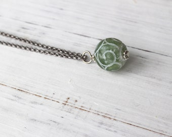 Green swirly pendant, minimalist necklace, antique silver necklace with pendant, carved green jade necklace, simple pendant necklace