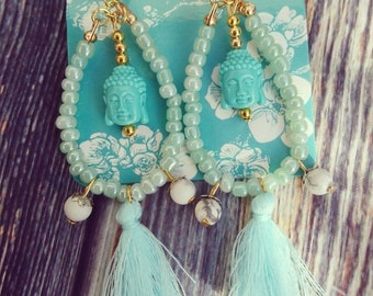 Turquoise buddha earrings from now on. With tassels at the bottom.
