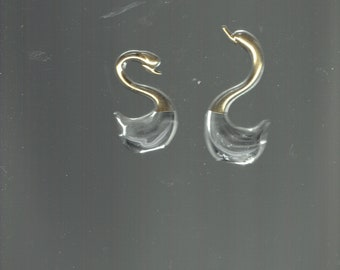 2 beautiful glass swans with gold necks and heads