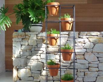 Vertical garden. An asymmetric design holding six terracotta pots.