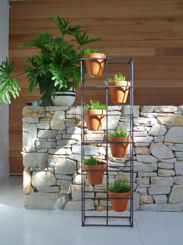 Vertical garden an asymmetric design holding six terracotta zoom workwithnaturefo