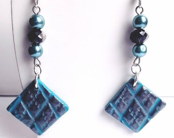 Silver relief and turquoise dangle earrings