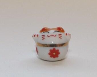 Small Porcelain Cat Bead - With Red Flower - Maneki Neko - Beckoning Cat, Lucky Cat - Raised Paw