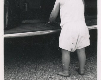 vintage photo 1940 Little Curl Hair Toddler Boy Plays on Car Runner From Back
