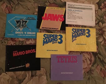GnG, Jaws, Kid Icarus, SMB, SMB3, Tetris, (7) Instruction Manuals - Nintendo NES