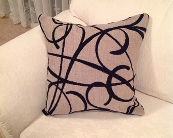 Black and cream cushion
