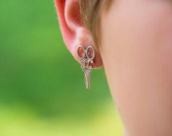 Scissor stud earrings, silver in color