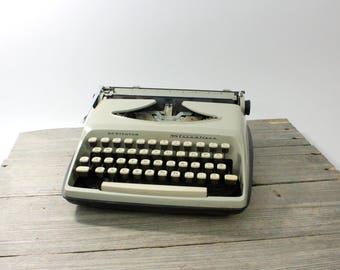 Remington Streamliner portable typewriter, tan. Made in Holland. Typewriter, portable, Remington Streamliner, Remington, vintage typewriter