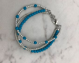 Multi strand turquoise and silver bracelet