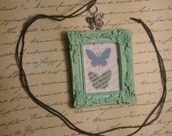 Butterflies in blue pendant