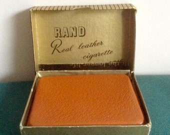 "Vintage ""Rand"" Pigskin  Cigarette Case. Boxed. Measures 4inches by 3.25inches."