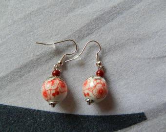 Red/white porcelain bead earrings.