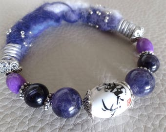 Bracelet made of purple and white felted wool with beads