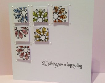 Hand stamped and coloured greetings card.