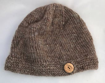 Wool beanie with wooden button tab