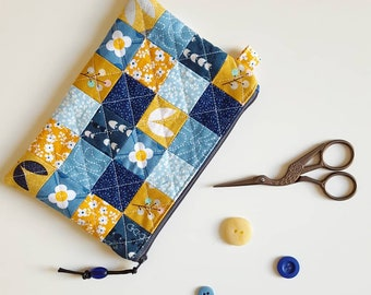 Handmade patchwork quilted zipped pouch. Mustard and blue. Useful pouch made in cotton fabric.