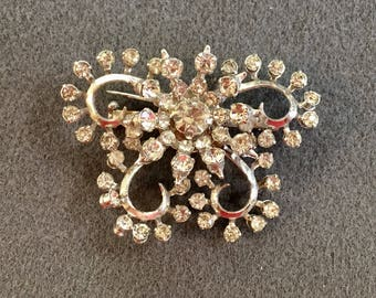 Vintage Clear Rhinestone Brooch with Riveted Construction .  Free shipping
