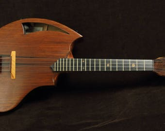 Unique Rays Rootworks ukulele. Baritone, Tenor and Concert. Each one is a unique piece of art.